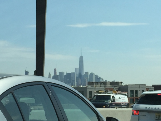 The financial district and One World Trade Center from the (gridlocked traffic at the) Lincoln Tunnel